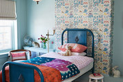 A little girl's room full of colorful prints