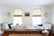 Canvas cots form a long bench in a light-filled living room