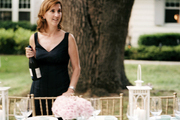 Susan McGrath setting the table for an outdoor dinner party