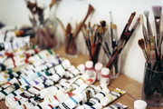 Painting supplies atop a wood table