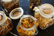 Here are glass jars full of herbs and cooking ingredients.