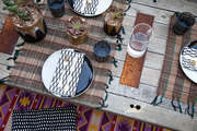 A tabletop of tribal and geometric patterns