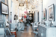 A gathering of chandeliers hung above neutral home accessories