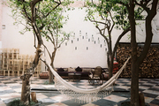 A hammock hung in an outdoor living area