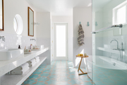 A minimalist bathroom with blue and gray tiles.
