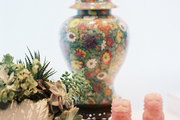 A floral ginger-jar lamp with a pair of foo dogs