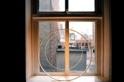 A circular light fixture on a windowsill