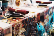 A white dining table set with colorful table runners