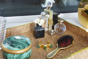 Jewelry and beauty needs arrayed on a decorative tray
