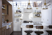White and gold contemporary kitchen lit by large upstairs window.