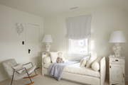 Beige and white kids room with contemporary furniture.