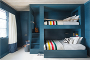 Blue bunk beds in kids room.