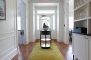 A chartreuse carpet runner in a white hallway