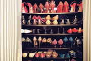 A collection of shoes organized on shelves