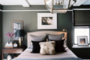 A masculine bedroom with gray walls