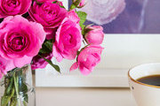 Pink roses on a bedside table