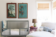 A toddler bed and chaise longue with antique hand-painted panels