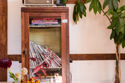 A vintage cabinet showcases records and a record player.