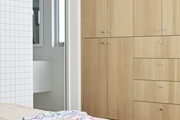 Built in cabinets make for crisp, tidy storage space in a bedroom.