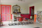 Pendant lights and bright-colored eclectic furnishings in a dining room