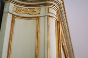 An antique armoire with gilded details