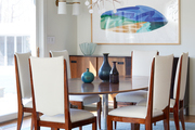 Contemporary blue and white dining room with midcentury accents.
