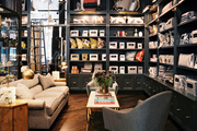Gray built-in shelving surrounds a seating area