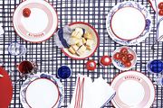 A red, white, and blue tabletop display for a casual and colorful pizza party