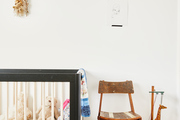 A crib, chair, and toys in a nursery.