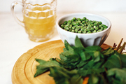 Ingredients for minted pea soup atop a wooden tray
