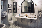 Basket-weave tile and a double-sink vanity in a marble bathroom