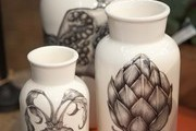 Ceramic urns emblazoned with vegetable illustrations at Napa Valley's Poor House