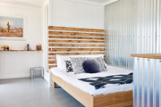 A vacation rental bedroom with metal and wood accents.