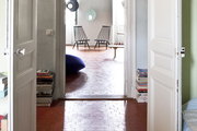 Rustic red tile lines the floors of this Parisian style apartment.