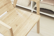 Here is a closeup on the wooden chair detailing.