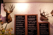 Daily chalkboard menus and stag heads at The Thomas restaurant and Fagiani's Bar in downtown Napa