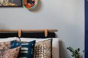 Bedroom detail of wall art and grasscloth textiles.