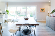 A contemporary dining space with mud-century modern decor pieces.
