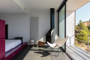 A light-filled guest room and adjoining terrace