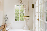 A modern planter in a bright space.