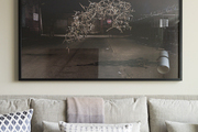 Large framed art hanging on a living room wall