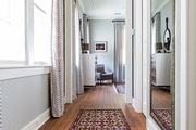 A view of a hallway with a Bohemian runner rug.