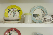 Colorful dishware on exposed shelves