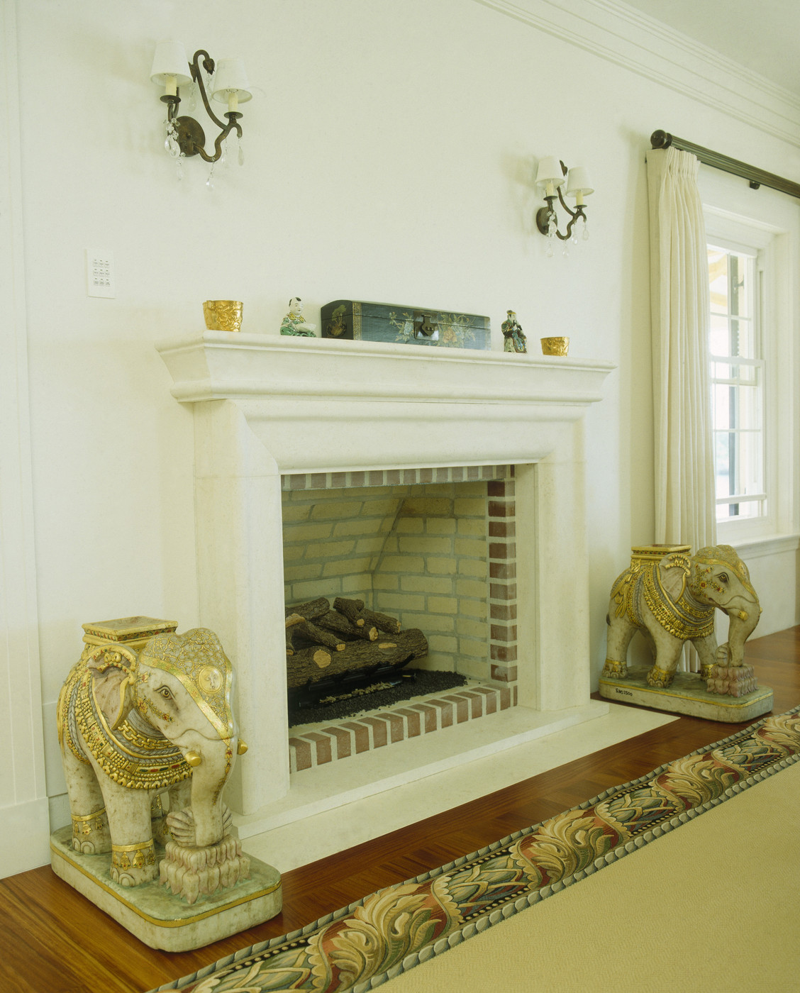 Pair of elephant statues on hearth photos design ideas Decorative hearth