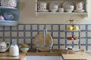 A print and graphic text filled kitchen.
