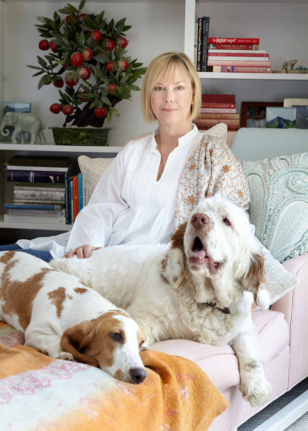 Designer Annie Selke with two of her dogs, a basset hound and a Clumber spaniel.