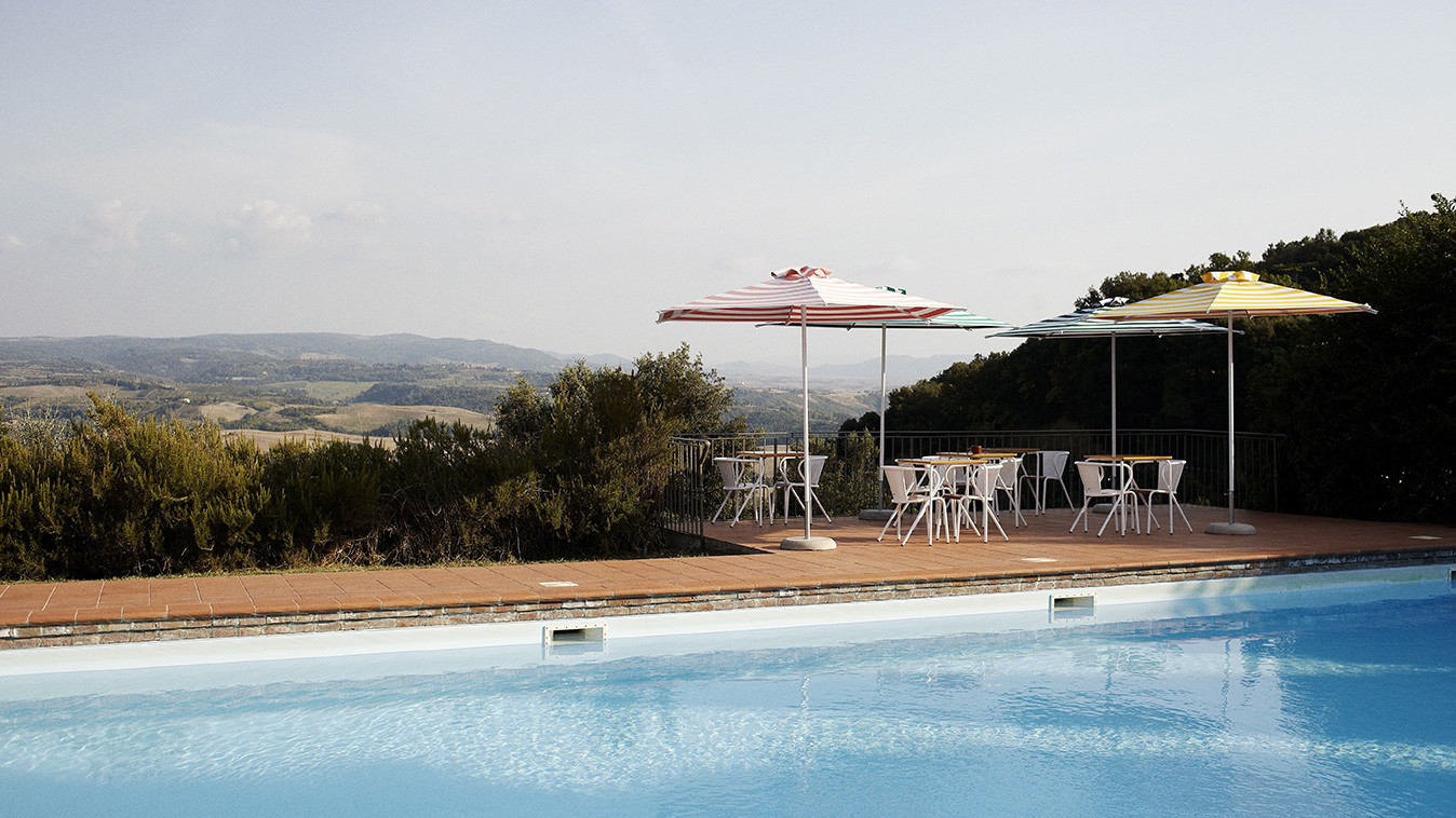 Villa Lena is an artist's retreat tucked high above the sloping hillsides of Tuscany.