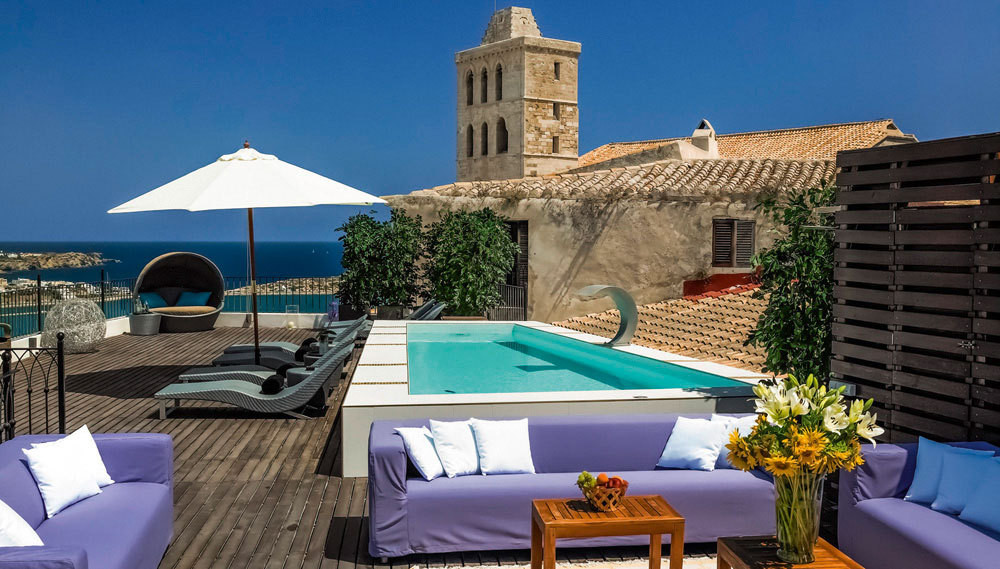The pool terrace at Palacio Bardaji, in Ibiza's historic center.