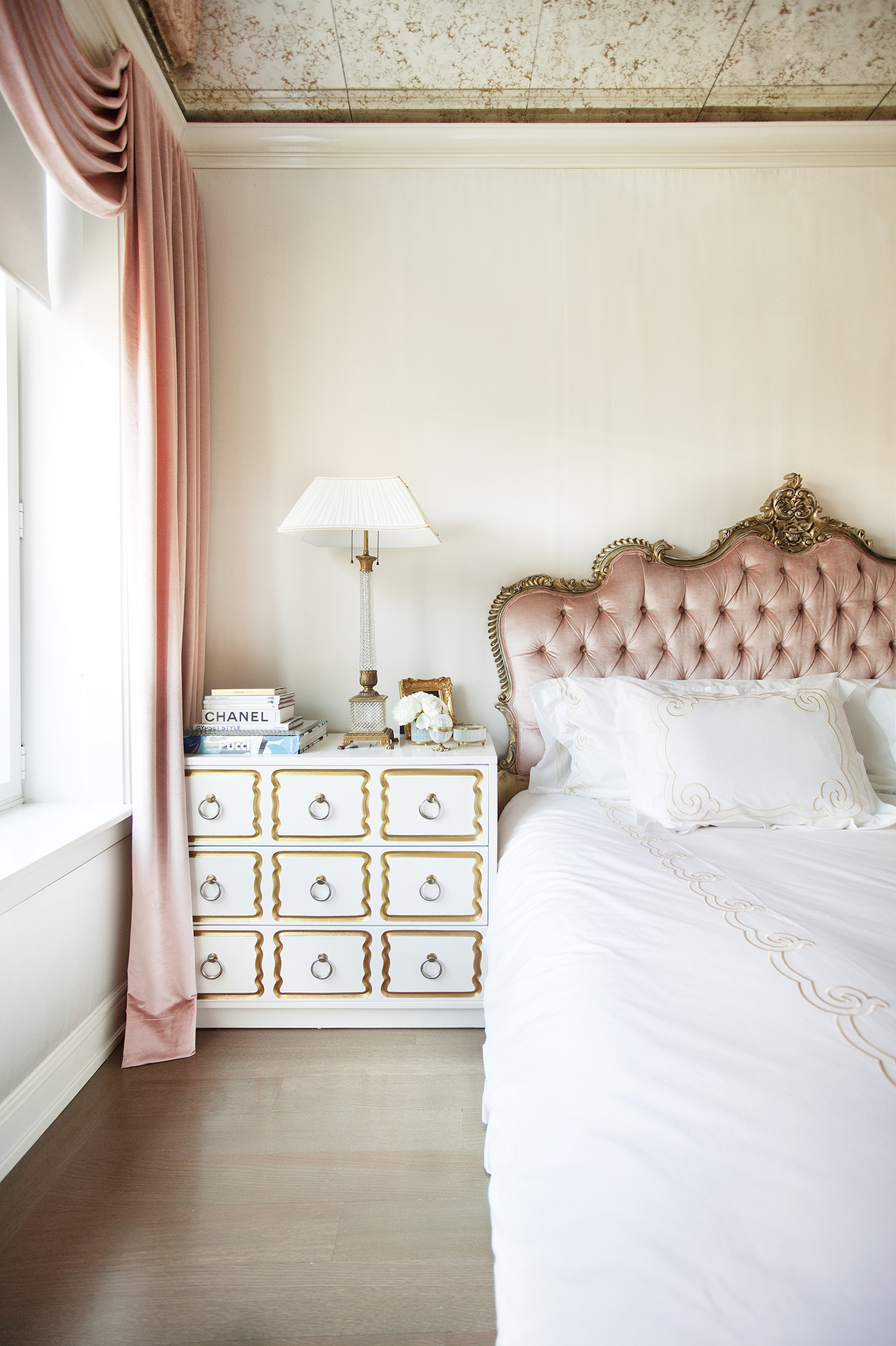 Blush-pink silk velvet is used for the headboard and drapery.