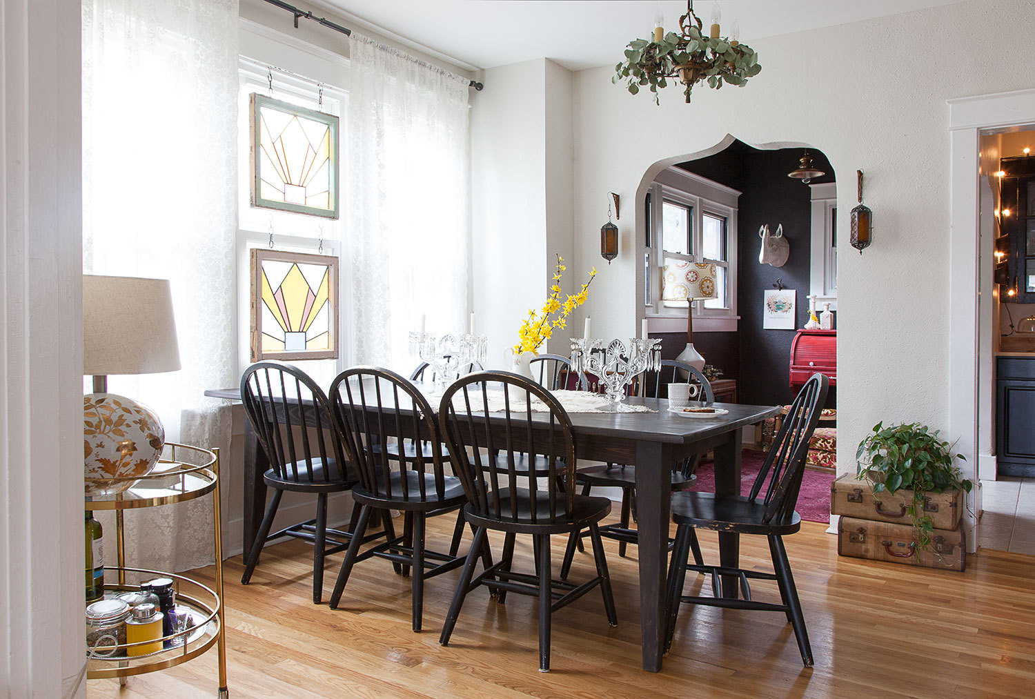 The dining table, which is often surrounded by out-of-town guests, is another piece from Lindsey's family farm.